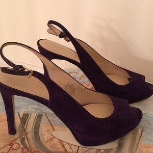 Purple suede sling back shoe with peep toe.